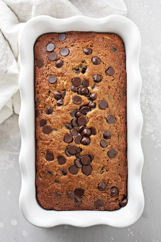 A loaf of Lactose Free Zucchini Bread in a white baking dish.