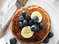 A stack of Dairy Free Banana Pancakes with a fork.