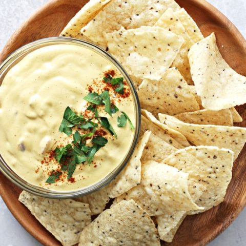 Dairy Free Nacho Cheese on a platter with chips.