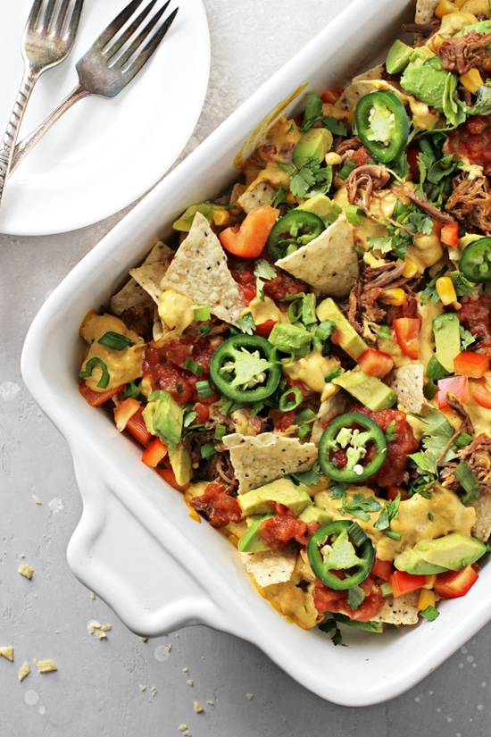 A white baking dish filled with Dairy Free Nachos.