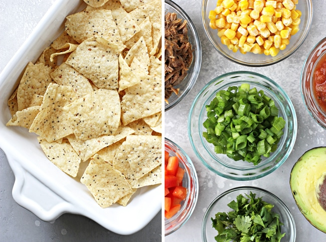 Tortilla chips in a baking dish and chopped veggies in bowls.