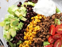 A white plate filled with Dairy Free Taco Salad.