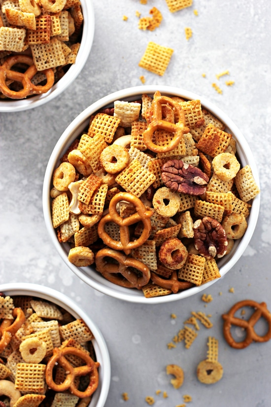 Three bowls of Gluten Free Dairy Free Chex Mix.