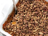 A Dairy Free Sweet Potato Casserole in a white baking dish.