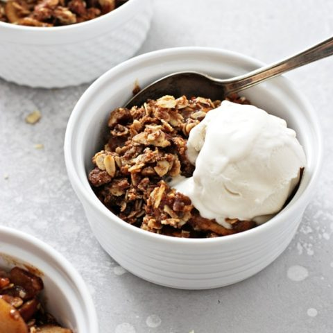 Three bowls of Gluten Free Dairy Free Apple Crisp topped with ice cream.