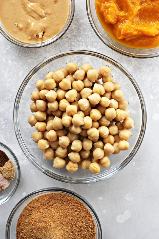 Chickpeas, pumpkin, spices and sugar in small bowls.