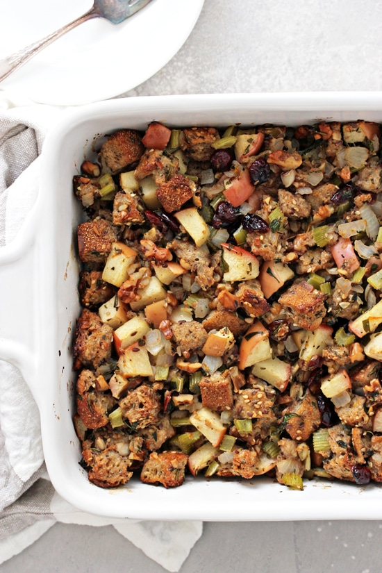 Dairy Free Stuffing in a baking dish with plates to the side.
