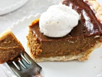 A slice of Dairy Free Pumpkin Pie with a bite taken out with a fork.