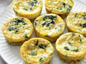 A white plate filled with Dairy Free Egg Muffins.