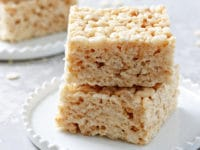 Two Dairy Free Rice Krispie Treats stacked on a plate.
