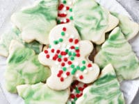 A white plate filled with decorated Dairy Free Sugar Cookies.