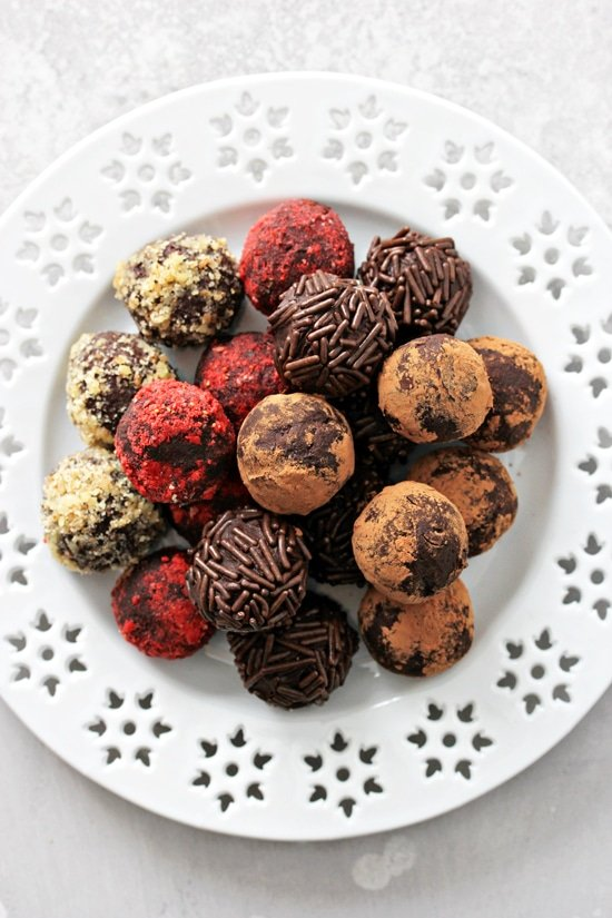 A white plate filled with Dairy Free Truffles.