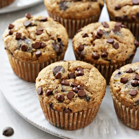 A white plate filled with Dairy Free Banana Chocolate Chip Muffins.