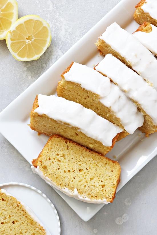 Sliced Dairy Free Lemon Loaf on a white platter.