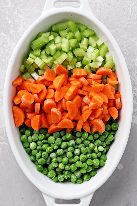 Chopped veggies in a white dish.