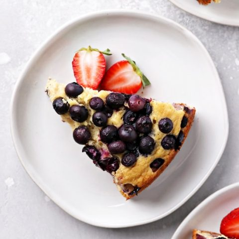 Three slices of Dairy Free Blueberry Cake on plates.