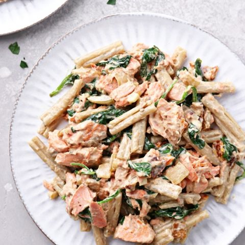 Two plates filled with Dairy Free Salmon Pasta.