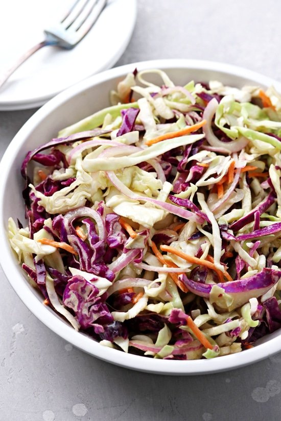 A white bowl filled with Dairy Free Slaw.