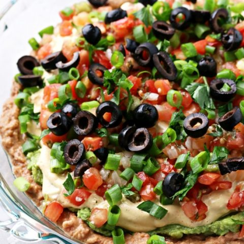 A pie dish filled with Dairy Free Taco Dip.