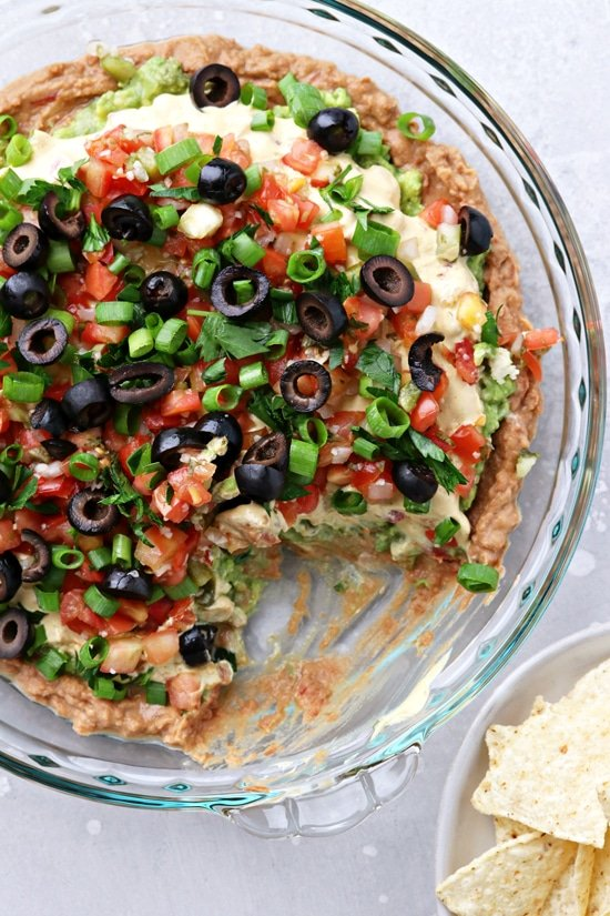 Dairy Free Seven Layer Dip with a bite taken out.