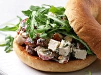 Dairy Free Chicken Salad piled on a bagel.
