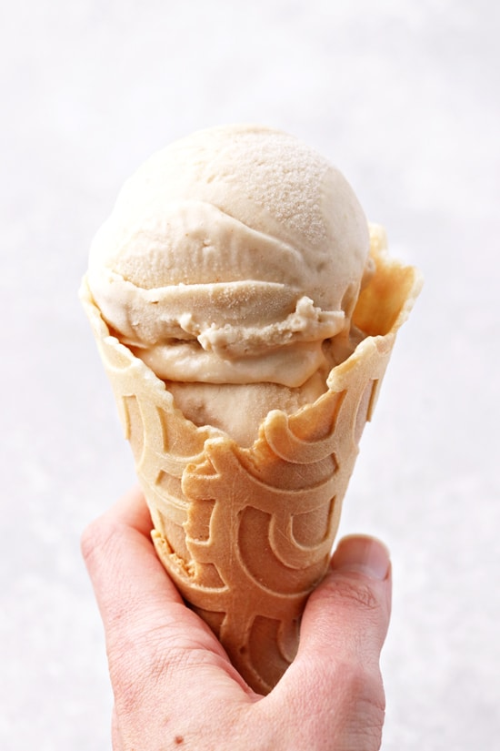 A waffle cone filled with Dairy Free Peanut Butter Ice Cream.