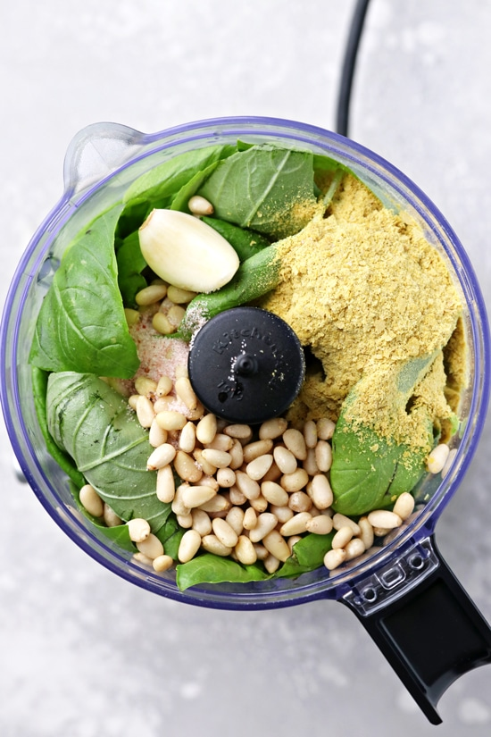 Basil, pine nuts, nutritional yeast and garlic in a food processor.