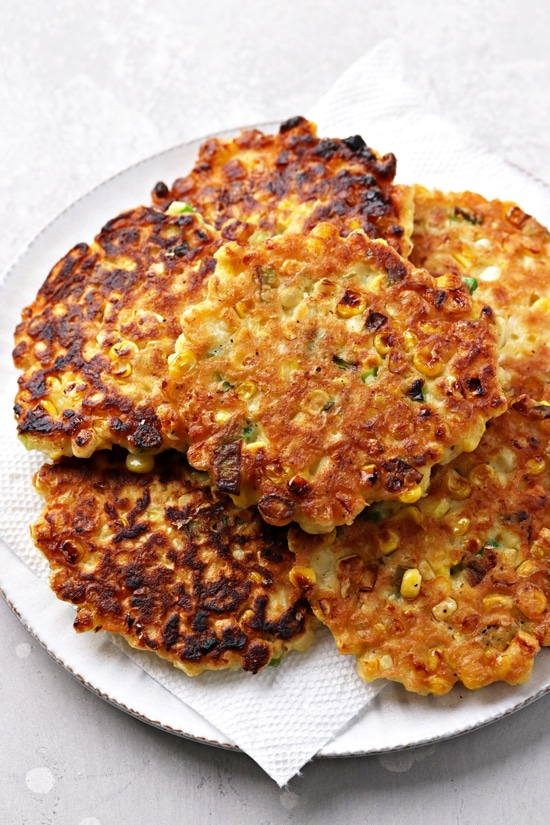 A pile of Healthy Corn Fritters on a white plate.