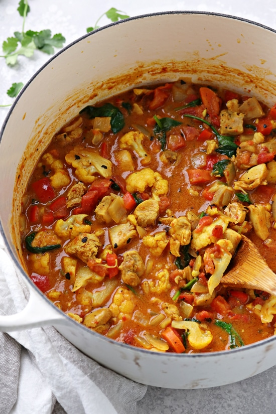 A white pot of Dairy Free Curry Chicken.