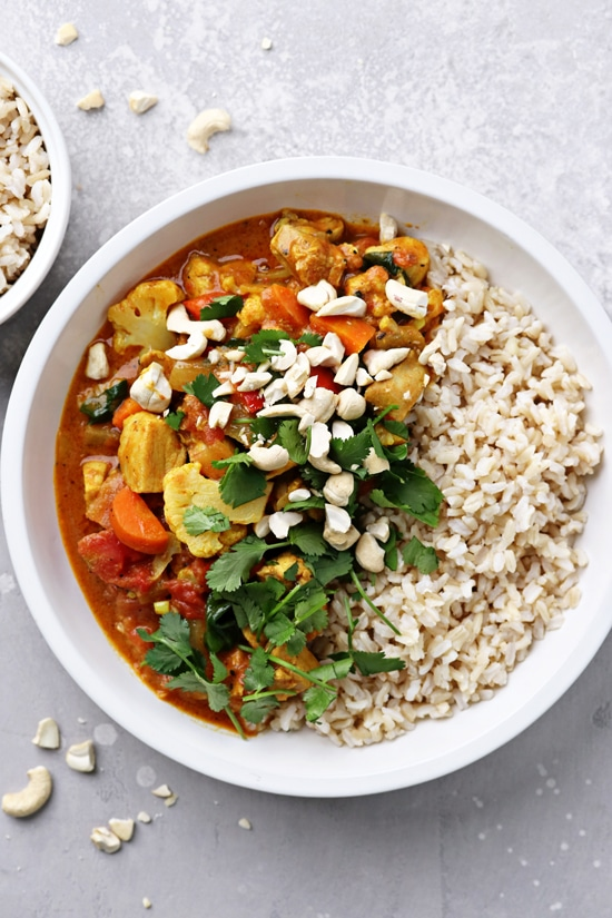 A bowl of Dairy Free Curry with rice to the side.