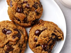 Three Dairy Free Pumpkin Chocolate Chip Cookies on a plate.