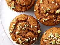 Several Dairy Free Pumpkin Muffins on a white plate.
