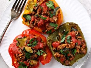 Three Dairy Free Stuffed Peppers on a plate.