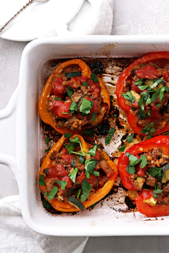 A baking dish filled with Gluten Free Dairy Free Stuffed Peppers.