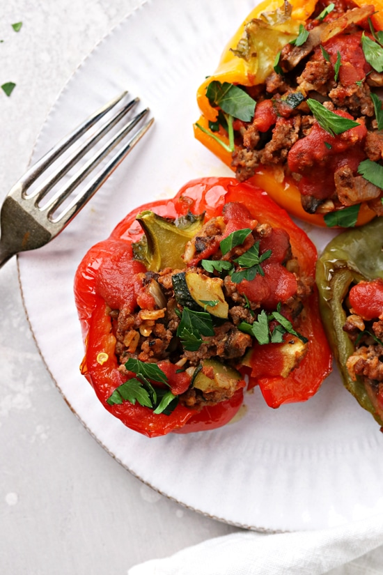 Several Dairy Free Stuffed Bell Peppers on a plate with a fork.